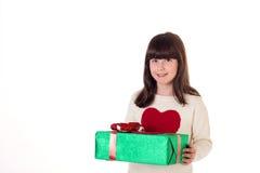 Muchacha en la Navidad con las cajas de regalo Imagenes de archivo