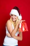 Muchacha en la Navidad con los regalos Fotografía de archivo libre de regalías