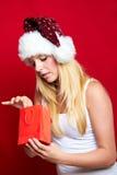 Muchacha en la Navidad con los regalos Imagen de archivo