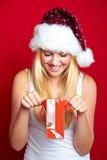 Muchacha en la Navidad con los regalos Foto de archivo libre de regalías