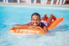 Muchacha en la piscina Fotos de archivo libres de regalías