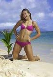 Muchacha en la playa con la palmera del bebé Fotos de archivo libres de regalías
