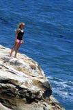 Muchacha en la roca Imágenes de archivo libres de regalías