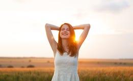 Muchacha en la salida del sol Fotografía de archivo
