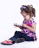 Muchacha en la sentada del suéter Foto de archivo libre de regalías