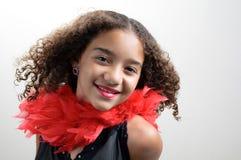 Muchacha en la sonrisa roja de la boa Imágenes de archivo libres de regalías