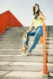 Muchacha en las escaleras con el monopatín Fotografía de archivo libre de regalías