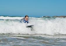 Muchacha en las ondas Foto de archivo libre de regalías
