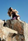 Muchacha en las rocas Foto de archivo libre de regalías