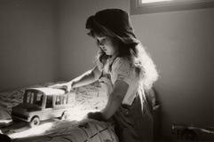 Muchacha en las sombras Foto de archivo libre de regalías