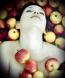 Muchacha en manzanas Imagen de archivo libre de regalías