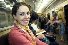 Muchacha en metro del subterráneo foto de archivo