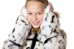 Muchacha en orejeras peludas Imagenes de archivo
