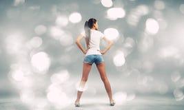 Muchacha en pantalones cortos Fotografía de archivo