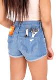 Muchacha en pantalones cortos con las herramientas Foto de archivo