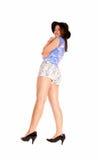 Muchacha en pantalones cortos y sombrero Imagen de archivo