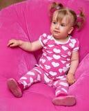 Muchacha en pijamas rosados Foto de archivo libre de regalías