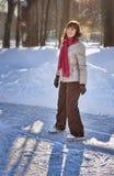 Muchacha en pista del patín del invierno Fotos de archivo libres de regalías