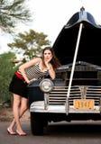 Muchacha en rayas con el coche de la vendimia Imagen de archivo libre de regalías