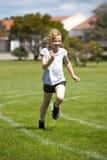 Muchacha en raza de los deportes Fotografía de archivo libre de regalías