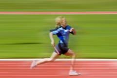 Muchacha en raza de los deportes Fotos de archivo libres de regalías