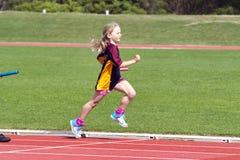 Muchacha en raza de los deportes Fotografía de archivo