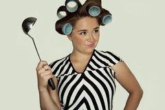 Muchacha en rodillos del pelo Imagen de archivo libre de regalías