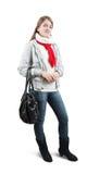 Muchacha en ropa hivernal con el bolso sobre blanco Fotos de archivo libres de regalías