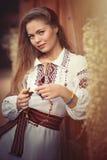 Muchacha en ropa nacional Fotos de archivo