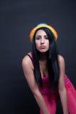 Muchacha en rosa con el sombrero colorido Imagenes de archivo
