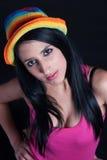 Muchacha en rosa con el sombrero colorido Fotos de archivo libres de regalías