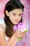 muchacha en rosa con las flores Fotos de archivo