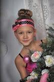 Muchacha en rosa en la Navidad Imagen de archivo