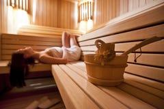Muchacha en sauna Foto de archivo