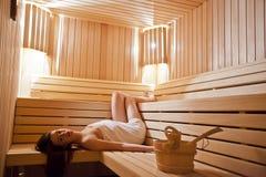 Muchacha en sauna Imagenes de archivo
