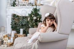 Muchacha en silla Imagen de archivo libre de regalías