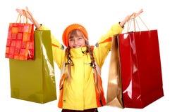 Muchacha en sombrero anaranjado del otoño con el bolso de compras. Foto de archivo libre de regalías