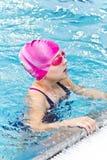 Muchacha en sombrero de goma rosado Imágenes de archivo libres de regalías