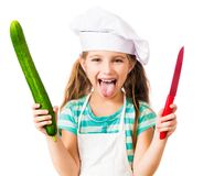 Muchacha en sombrero del cocinero Imagenes de archivo