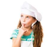 Muchacha en sombrero del cocinero Foto de archivo libre de regalías