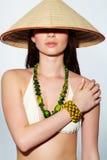 Muchacha en sombrero del cono Fotografía de archivo