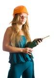 Muchacha en sombrero duro con el taladro imagenes de archivo