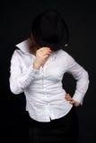 Muchacha en sombrero negro Foto de archivo libre de regalías