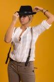 Muchacha en sombrero negro Fotografía de archivo