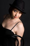 Muchacha en sombrero negro Imagenes de archivo