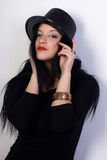 Muchacha en sombrero negro Imagen de archivo libre de regalías