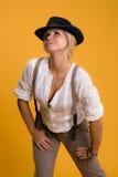Muchacha en sombrero negro Fotos de archivo