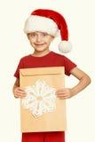 Muchacha en sombrero rojo con la letra a santa - el concepto de la Navidad de las vacaciones de invierno, amarillea entonado Foto de archivo libre de regalías