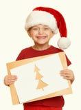 Muchacha en sombrero rojo con la letra a santa - el concepto de la Navidad de las vacaciones de invierno, amarillea entonado Imagen de archivo libre de regalías