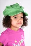 Muchacha en sombrero verde Fotos de archivo libres de regalías